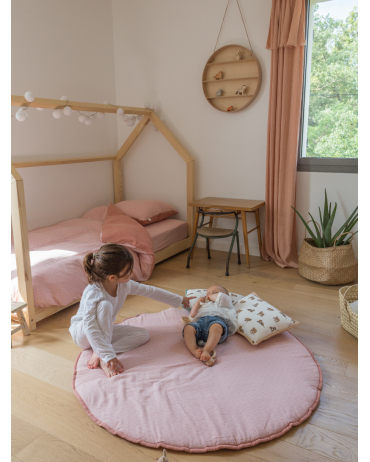 Pink Round Play Mat in the baby's room