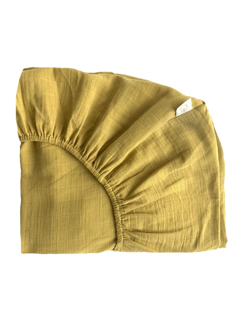 Small curry coloured fitted sheet