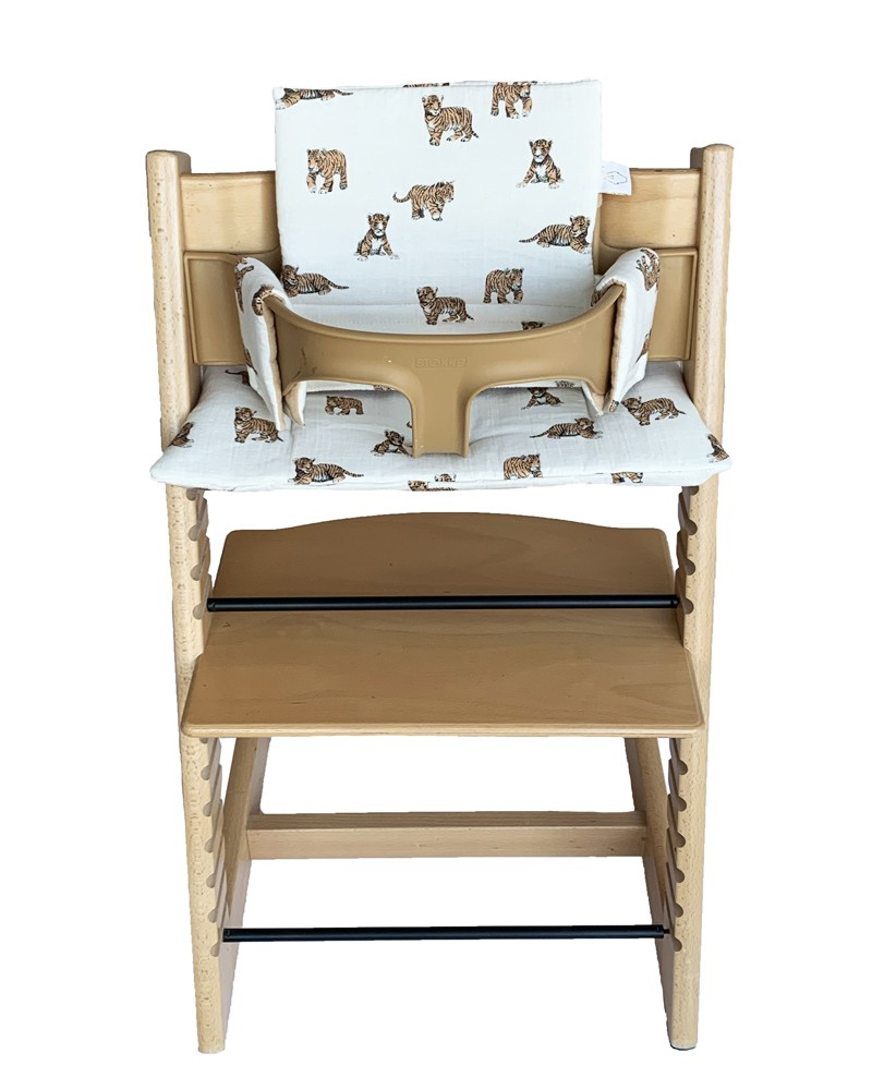 High chair with a tiger pattern cushion
