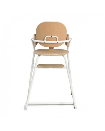 White evolutionary high chair of the brand tibu collab charlie crane